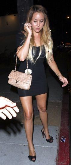 nude purse and black slingback pumps