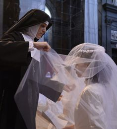 Mother Caroline-Marie helping a new novice of the Institute of Christ the King with her bridal veil.