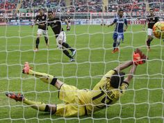 AC Milan's Carlos Bacca scores on a penalty kick past Sassuolo goalkeeper Gianluca Pegolo during a Serie A soccer match in Milan, Italy.  Luca Bruno, AP