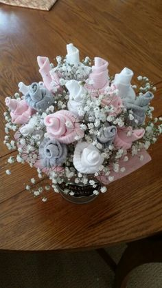 Baby sock bouquet. Sierra I will buy the socks and flowers these would be so cute on some tables in a teapot or teacup u already have. What do You think?