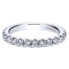 14K white gold 1.50cttw french pave set eternity diamond band. This 1 1/2ct eternity diamond anniversary band or diamond wedding band features G/SI quality diamonds. Price based on finger size 6. Desi