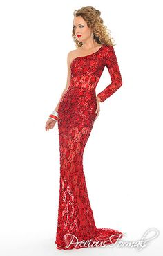 Precious Formals Style P8870 This stunning one shoulder long sleeve gown has a train and is fully embroidered with hand sewn sequins. The sheer lace on the arm, torso and legs gives it a sexy look.