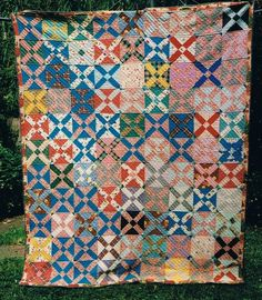 Bright quilt | 1940's made from cotton feedsack and dress clippings |