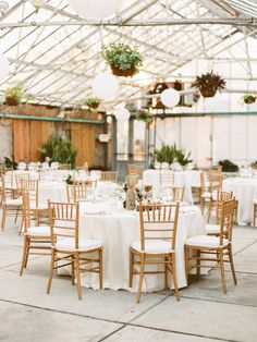 Indoor rustic wedding tables: http://www.stylemepretty.com/2014/10/23/elegant-philadelphia-greenhouse-wedding/ | Photography: Love by Serena - http://lovebyserena.com/