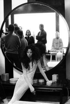 1967. The crew are conferring just across the room, but Donyale, cigarette in hand, seems to be in a world of her own. Photo by Jack Garofalo.