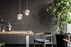 The Lamp Vita Acorn from Vita Copenhagen over a dining place. Wonderful white Lamps