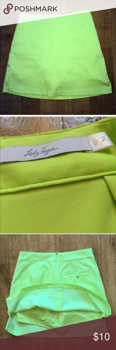 Lady Hagen Neon Skort•Size 2 Lady Hagen Neon Green/Yellow Skort•Size 2•Zipper Closure in Back, with Stretchy Shorts Built In•Truest Representation of the color is Photo #3 showing the Tag Lady Hagen Skirts Mini