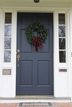 Navy front door with white side panels