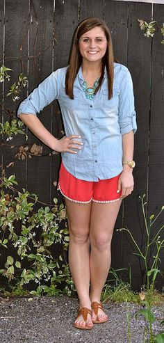 Chambray top, statement turquoise necklace, red pom shorts, cognac sandals. Super cute, relaxed summer outfit available at www.studio3-19.com! -Studio 3:19