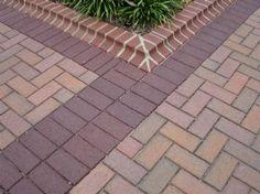 Patio edge with English Ironspot pavers. Pine Hall Brick.