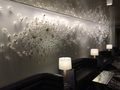 """Brises_de_printemps_small_carousel - White """"RELIEF"""" on textured wall"""