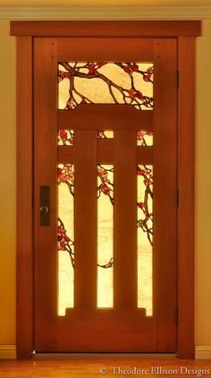 Mahogany door with natural oil finish and flowering branch art glass - Theodore Ellison Designs and The Craftsman Door Company