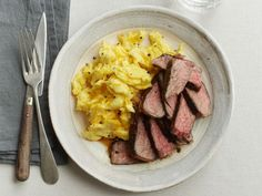 Rosemary Steaks with Cheesy Eggs: After Sunny Anderson infuses the meat with rosemary and liquid smoke, her decadent steak and eggs come together in a flash. Don't skip the garlic-rosemary butter.
