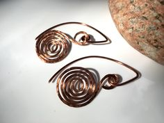Rustic glam. Hammered spiral earrings, in copper or silver. https://www.etsy.com/listing/269063022 #etsymntt #jewelry #handmade
