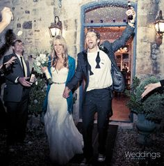 Bride and groom exiting wedding reception ~ Photo: Select Studios