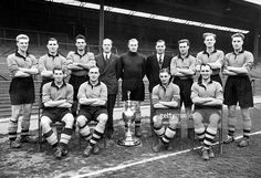 Wolverhampton Wanderers with the League Championship trophy, circa August 1954. Back row, left to right: Ron Flowers, Bill Shorthouse, Eddie Stuart, Stan Cullis (manager), Bert Williams, Joe Gardiner (trainer), Jimmy Mullen, Bill Slater and Roy Swinbourne; front row, left to right: Peter Broadbent, Billy Wright, Johnny Hancocks and Denis Wilshaw.
