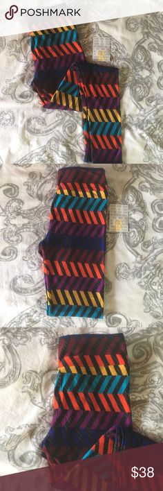 LulaRoe leggings 🦄 SUPER cute and HTF LulaRoe leggings. I've seen this chevron pattern a lot, but not with these vibrant colors. Will all of these colors, you can pair these with so many options. OS (2-12), dark gray/black background. Pictures depict colors well. NWT ❌NO TRADES❌ Price is firm!! 🦄 LuLaRoe Pants Leggings