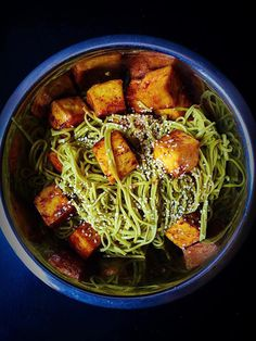 This easy vegan dish combines vibrant green tea soba noodles, toasted sesame seeds, and umami baked tofu stir fried in a spicy and flavorful sauce!