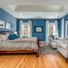 Main level owner's retreat with a bay window, hardwood flooring, skylight, recessed lights, blue paint and dual custom walk-in closets. Listed for $1,250,000 in Vienna, VA by The Casey Samson Team, a Wall Street Journal Top Team in Northern Virginia.