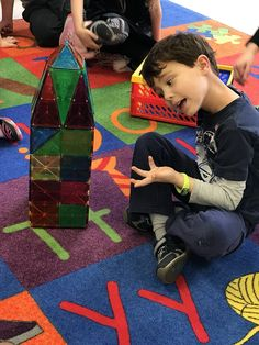 """A fun week building Mt. Vernon with MagnaTiles and Abe's log cabin. Plus our new light table!"""