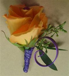 Purple and Orange Boutonniere. Switch the purple to teal and that is perfect!