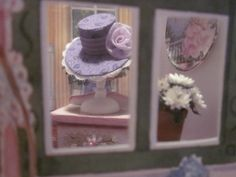 Nov. 30, 2014 - It took only a few days to put the bag together.  This view through the window shows the hat, flowers and purple nightable which was a left over piece from the purple bedroom in the Farmhouse (there was no room in the bedroom for it).