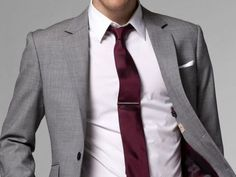 Charcoal grey suit with red tie