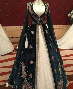 indian designer wear Image may contain: one or more people and people standing Indian Gowns Dresses, Pakistani Dresses, Indian Outfits, Renaissance Dresses, Medieval Dress, Turkish Wedding Dress, Dress Dior, Fantasy Gowns, Indian Designer Wear