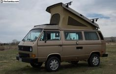 This is our EXACT Westy!!! (minus the rack, but we're adding something simiar to ours for mounting solar panels) Although, it doesn't look like this anymore...we just had it painted Honda Cypress Green (pretty!). - 1985 VW Vanagon Westfalia Camper