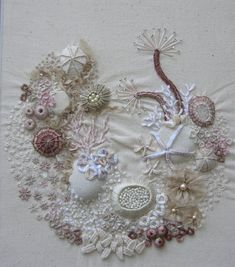 Rock Pool, embroidered calico by Barbara Brackman Jersey UK.  Art Escapes: Embroideries