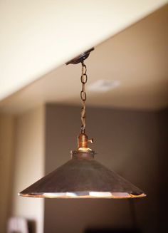 I love this industrial light fixture, designed with authentically old parts made to look vintage. It would look great over a bar, kitchen island, bathroom vanity.