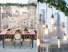 hanging edison bulbs over wedding reception table