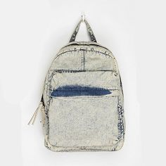 Om15 Backpacks That Are Too Cool For School: A touch of the acid wash '80s with your '90s style backpack.     Urban Outfitters - $42