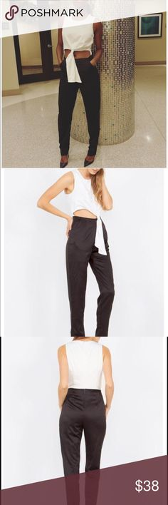 Front tie Jumpsuit NWT | This beautiful colorblock Jumpsuit is perfect for special occasions, dinner date or just a fun night out with the girls! Features: sleeveless, self tie in front, side pockets. Invisible zipper closure on back | Color: Black/White | Material: Polyester (Satin like material) | Runs true to size | Material: Polyester | Measurements (approx): XS (0/2), Small (4/6), Medium (8/10), Large (12/14) | Model wearing Small | Ships within 1 business day Sugarlips Pants Jumpsuits…