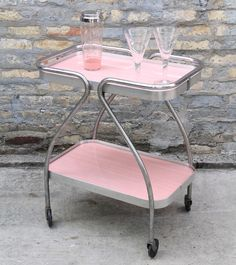 Wow your guests with this pink bar cart at your next party! Vintage, 1950s Pink formica and chrome Measures 25 inches wide x 15 inches deep x 29 inches tall Available for pickup at our stor...