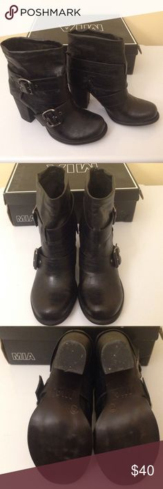 """Mia Corporal Black Boots 7.5 Mia Corporal Black Boots Size 7.5 EUC Worn once with box. Show them who's boss in this Corporal boot from MIA. This bold boot has a distressed leather finish and decorative buckles and straps that really show off tough-girl side. A durable, non-slip sole and low-cut shaft make this boot as practical as it is pretty. Synthetic sole Shaft measures approximately 7"""" from arch Heel measures approximately 3"""" Boot opening measures approximately 11 1/2"""" around Mia Shoes…"""
