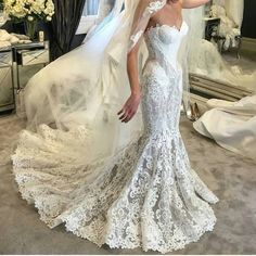 Haute couture mermaid wedding dresses like this can be very expensive.  But our design firm can make a replica of any couture bridal dress for you that will look similar but cost much less than the original. Ornate lace and embroidery like this can be replicated to look very close to the original. Contact us for pricing on custom wedding dresses & #replicas that are affordable by emailing us from our website.