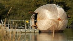 BBC News Video - The man who lives in an egg: The wooden egg floating on the water in a quiet inlet of Hampshire's Beaulieu River, is home, workspace and laboratory for artist Stephen Turner.  For the next year he is living and working in the Exbury Egg, as part of a project to explore the nature of the landscape and the meaning of place, amidst environmental changes.