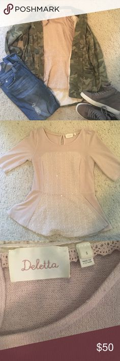 Anthropologie peplum top Adorable peplum top from Anthropologie. Excellent condition. Worn maybe once or twice.  Warmer sweater like material Anthropologie Sweaters