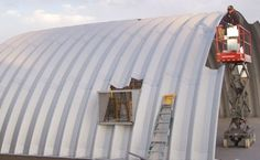 Quonset hut building one arch at a time in Concho, Arizona