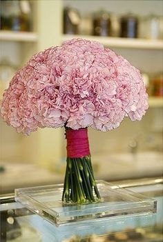 Light pink wedding centerpiece image.jpg Make into a kissing ball on top of a cyllinder with the ribbon accent.