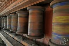 Spinning Buddhist Prayer Wheels in the Himalayan Mountains of Nepal