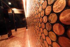 Homeslice Bathroom covered in pennies (wall and floor)