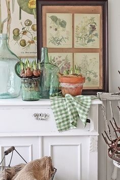 Farmhouse Style with Green Jugs, a White Cabinet and Neutral Accessories