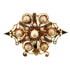 Beautiful Arrows Victorian Pearl Brooch. Bold design makes this Victorian pin unique and beautiful. The elaborate construction consists of gold and black enamel arrows that extend out of the piece like they are flying from a bow. The pin also has 13 pearls adorning the piece in a circular design. This piece is truly from the 1800s