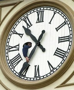 Worker Bill Harper manually moves time ahead on the Market Hall Clock Tower in downtown Peterborough, Ont. on Saturday, April 3, 2004.