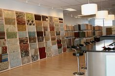 Large custom samples adorn the wall display in our decorative carpet and rug showroom.