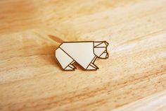 bear origami pin... but i like to think it's a bulldog.