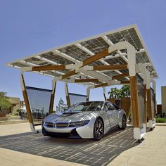 """BMW Solar Carport Concept - The carport is constructed largely of bamboo, which BMW said is a """"particularly sustainable raw material."""" To actually generate the electricity, there is high-grade glass-on-glass solar modules. Bmw I3, Solar Energy, Solar Power, Solar Carport, Solar Charging Station, Charging Stations, E Mobility, Carports, New Bmw"""