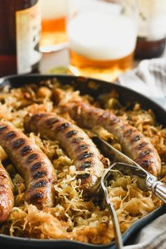 Baked brats in caramelized sauerkraut is a wonderfully easy sausage casserole that feeds the family on a weeknight, or a crowd on game day, you decide. It's a classic German recipe that everybody adores!